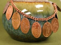 Free Ideas: Artbeads.com - 2nd Honeymoon Bracelet, Save those pressed pennies from vacation to make a bracelet!