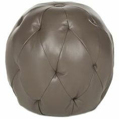 """Add eye-catching appeal to your living room seating group or home library with this tufted bicast leather ottoman, showcasing a globe silhouette and clay hue.  Product: OttomanConstruction Material: Leather, wood and foamColor: ClayFeatures: Button-tuftedGlobe silhouette  Dimensions: 18.1"""" Diameter   Cleaning and Care: Professional cleaning recommended"""