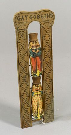 Four Small Lithographed Paper-on-Wood Toys, 19th century