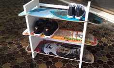 Made my own recycled shoe rack. Boards can be changed by sliding them out and a different one in.
