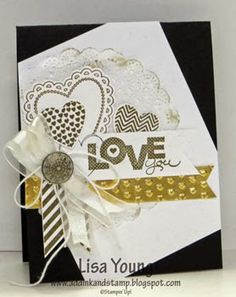 Stamps: Hearts a Flutter, Off the Grid, Dictionary, Seasonal Sayings, Itty Bitty Banners - Card Stock: Whisper White, Basic Black, Gold Foil - Ink: Soft Suede, Gold Encore  - Other: Antique Brad, Bakers Twine, Organza ribbon, doily, Big Shot, Hearts a Flutter framelits, Adorning Accent folder, Finishing Touches edgelit