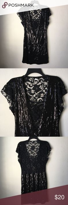 "Lace and Sequin Mini Dress An attractive mini sequin and lace dress. In the front, the low v-neck is covered by lace, the sleeves and top part of the back is made of lace. Dress is lined.  Length: 34"" Shoulder to Shoulder: 14"" Armpit to Armpit: 18"" Shoulder to Armpit: 10"" Waist: 16-18"" Frederick's of Hollywood Dresses Mini"
