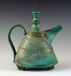 Love this handmade teapot by artist Sandy Terry. It is wheel thrown, altered and applied slip with multiple glazes and electric fired to cone 6 oxidation though of course I don't understand all that I just love it, LOL! by lela