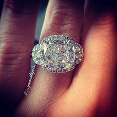 Cushion cut halo engagement ring with half moon side stones