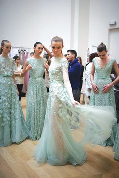 Mint green Elie Saab gowns backstage.