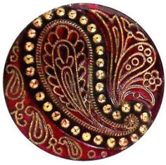 Red Glass w/ gold luster, Paisley design.