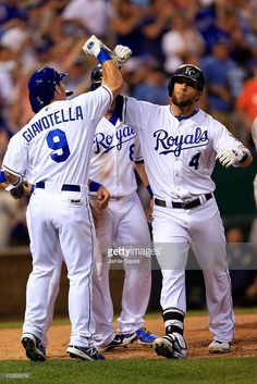 Alex Gordon of the Kansas City Royals is congratualted by Johnny Giavotella, David Lough, and Mike Moustakas after hitting a grand slam during the 5th inning of the game against the Cleveland Indians at Kauffman Stadium on July 2, 2013 in Kansas City, Missouri.