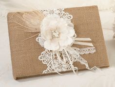 Guests will find themselves signing this unique burlap and lace guest book as they arrive at the reception. The guest book is covered in burlap and decorated with a rhinestone filled, hand crafted pap