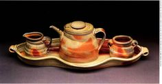 This wheel-thrown, altered porcelain tea set was created by Connie Christensen of Arvada, Colorado. Christensen was a 2004 Emerging Artist.