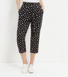 Pantalon court noir à imprimé pâquerettes Robe De Soirée, Mode Femme, Noir,  Pantalons e74c55c45848