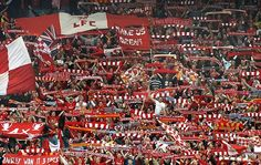 The famous Anfield Kop singing You'll Never Walk Alone ahead of a Liverpool match