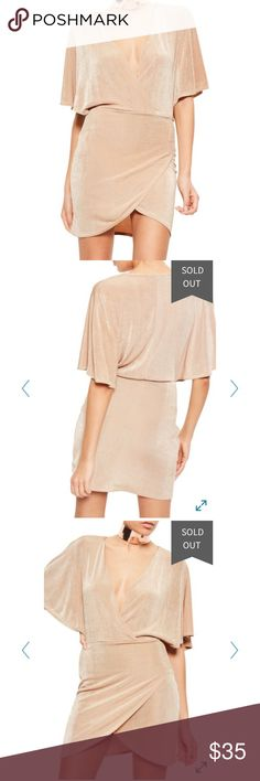 """Missguided • Gold Plunge Wrap Dress Dare to bare in a shimmering wrap-front dress cut with a plunging surplice neckline, fluttery kimono sleeves and a leg-flaunting length. - 33 3/4"""" length - Slips on over head - Plunging surplice neck - Elbow sleeves - Unlined - 95% polyester, 5% elastane Missguided Dresses Mini"""