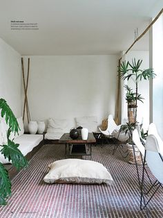 Poppytalk: An outdoor/indoor space gets a tropical look with the mix of bamboo and wicker and white.