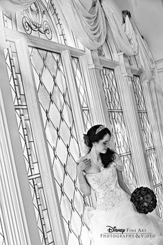 Beautiful black and white portrait of a bride by the stained glass windows at Disney's Wedding Pavilion #Disney #wedding #photography #WeddingPavilion