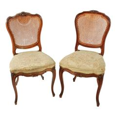 Two Walnut Bergére Salon Chairs   Two very similar 19th century solid walnut bergére back salon chairs.  The chairs have a shaped woven cane back with a decoratively carved top rail and an upholstered seat.  The chair stands on four cabriole shaped legs and has a serpentine front rail with a central carved decoration.  The chairs have their original silk upholstered seats that are now worn.  The chairs are in good original condition. (Circa 1870)  Height 89cm (35 inches) Width 46cm (18.1 inches) Bergere Chair, Armchair, Salon Chairs, Antique Chairs, Salons, Dining Chairs, Victorian, The Originals, Antiques
