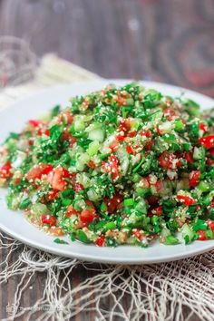Tabouli Recipe (Tabouleh) | The Mediterranean Dish. Authentic Middle Eastern tabouli salad with fresh parsley, mint, bulgur, finely chopped vegetables and a simple citrus dressing. See the step-by-step tutorial at The Mediterranean Dish food blog.