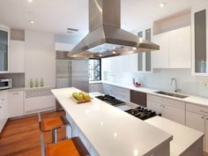 white kitchen with stainless steel | 117 East 24th Street, New York