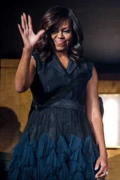 September 23, 2016 - The First Lady sports a button-down belted dress with a navy chiffon hem at the Kennedy Center in Washington.