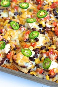 Seriously delicious nachos baked on a sheet pan with homemade tortilla chips, black beans, chicken and all the fixings. These Sheet Pan Chicken and Black Bean Nachos are sure to be a family favorite for an easy meal or game day great! Appetizer Recipes, Dinner Recipes, Appetizers, Tex Mex, Healthy Nachos, Clean Eating, Cooking Recipes, Healthy Recipes, Eat Healthy
