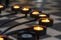 church prayer candles metal frame closeup perspective texture light