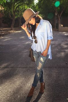 Fedora, distressed denim, and button up.