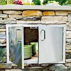 Building an outdoor kitchen? We give you the pros and cons of using stainless steel, teak and marine-grade polymer for built-in cabinet doors. | Photo: Wendell T. Webber | thisoldhouse.com