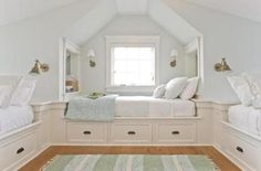 Beds are built in atop storage drawers in the third-floor bunk room.