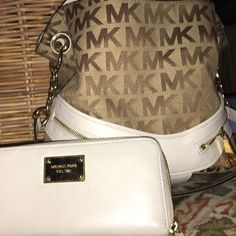 Cream and tan purse and matching wallet. Tan and cream gold zippers and cream wallet with gold plate and zipper both from Michael Kors. Excellent condition. Only used a few times. Michael Kors Bags Wallets