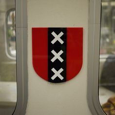 """The three Saint Andrew's Crosses on the Amsterdam Coat of Arms. Fire, floods, and the Black Death or """"Valiant, Steadfast, Compassionate?"""""""