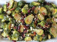 These Roasted Brussels Sprouts with Cranberries, Pecans, and Gorganzola are so easy to throw together! Salty, sweet, nutty, and delicious! This would make the perfect Thanksgiving side!