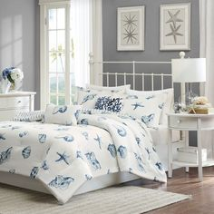 Bring a sense of the seaside into your home with this beautiful, casual 4-piece Beach House bedding collection. The shell pattern is printed in shades of blue onto a white, cotton brushed twill. The c