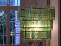 Recycled Ice Cream Spoon Chandelier via Tchochkes. I've seen other spoon chandeliers, but I love the color of this one.