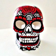 This hand painted ceramic sugar skull will light up the night with his candle lit spooky glowing eyes and toothy smile. Painted with heat set glazes