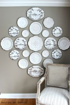 A large arrangement of plates dresses up an empty wall in this neutral dining room.