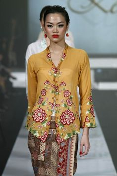 """Models showcase designs on the runway by Museum Arif Syakur Jogjakarta as part of the Opening Night """"Styling Modernity: A Tribute To Kebaya"""" show opening Jakarta Fashion Week 2010 at the Fashion Tent, Pacific Place on November 6, 2010 in Jakarta, Indonesia."""