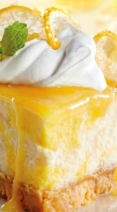 Dreamy Lemon Cheesecake ~ A water bath cooks the cheesecake gently, making it extra creamy with a smooth, crack-free top. You can make the lemon curd up to two weeks in advance; just be sure to store it in the refrigerator.