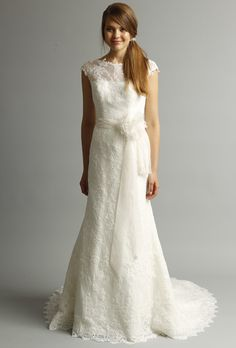 A lace wedding dress with illusion neckline from Alyne by Rivini's spring 2013 collection