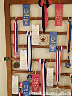Turn a crib railing into a medal holder (and disguises an ugly air vent)!  Such a cute display! eclecticallyvinta...