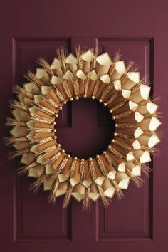 Paper Cone Gratitude Wreath Tutorial: These wreath will make you feel grateful every day, since it holds family members' declarations of gratitude.