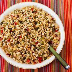 This Christmas Rice cooks in the oven and has red and green bell peppers, Parmesan, and Pine Nuts.  [Kalyn's Kitchen]