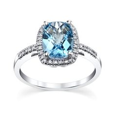 14K White Gold Blue Topaz and Diamond Ring 1/8 Carat Total Weight