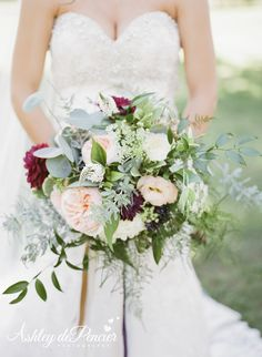 Lush bridal bouquet with lots of greenery, blush garden roses, burgandy dahlias and ribbon. Flowers by House of Flowers Bakersfield, Ca. Photo by Ashley DePencier Photography