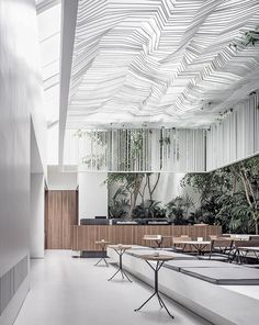 kois associated architects hang sculptural ceiling canopy over museum café in athens housed within the museum of cycladic art in athens, the clean and all-white interior has been created to reflect the artwork showcased in the museum. Interior Design Magazine, Interior Desing, Cafe Interior, Interior Architecture, Interior Sketch, Interior Livingroom, Restaurant Lighting, Restaurant Design, Restaurant Restaurant