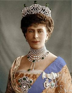 Queen Mary wearing Dehli Durbar parure.  This set of jewels was made in 1911 for King George V and Queen Mary's coronation in India.  The set uses the Cambridge cabochon emeralds and cleavings from the Cullinan diamond (Cullinan VII hangs from the pendant)