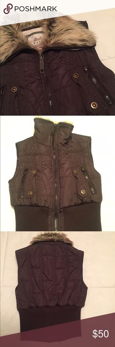 Outerwear vest Winter brown vest with thick center zipper and side pockets.  Furry beige and black collar. Jackets & Coats Vests