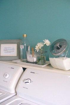 Store pods and powder detergents in glass penny candy jars. | 29 Incredibly Clever Laundry Room Organization Ideas
