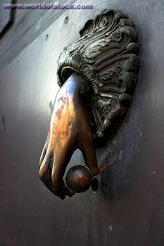 Stock Photo titled: Door Knocker. A Highly Sculpted Brass Hand Holding A Ball Makes An Excellent Door Knocker. Catania, Sicily, Italy, unlic...