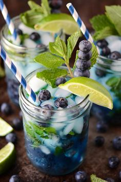 Blueberry Mojito - ingredients = 1 cup fresh blueberries, plus extra for garnish,  4 oz clear rum,  10 fresh mint leaves,  2 teaspoons sugar,  juice of 2 limes (have to use something else though since am allergic), 6 oz club soda,  ice.