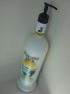 Beach Themed Bathroom..Rum Bottle with Shampoo/conditioner inside..(top looks better with a white pump head)