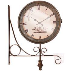 Reloj tipo aplique de estructura metálica, con dos caras y frentes de vidrio.  Medidas: 47 x 35...